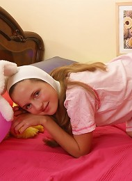 Lovely teen girl in bunny outfit exposing her small boobies