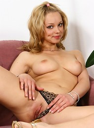 Watch as she shows off her pert braests and shaven pussy